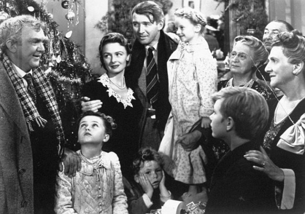 "**FILE** In this undated publicity still photo, James Stewart, center, is reunited with his wife, Donna Reed, left, and children during the last scene of Frank Capra's 1946 classic, ""It's A Wonderful Life."" For its ninth annual celebration of cinema, the American Film Institute aims to uncover the ""most inspirational films of the century."" A list of 300 films deemed inspirational by AFI historians will be considered. Ballots went out this week to more than 1,500 actors, producers, writers and others in the industry. Among the suggestions are ""The Passion of the Christ,"" ""The Sound of Music,"" ""It's a Wonderful Life"" and ""8 Mile."" (AP Photo)"